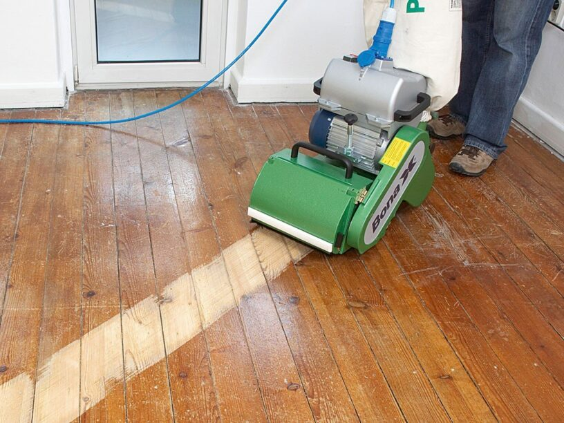 sand a wood timber or parquet floor