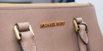 to tell a fake vs genuine Michael Kors Jet Set